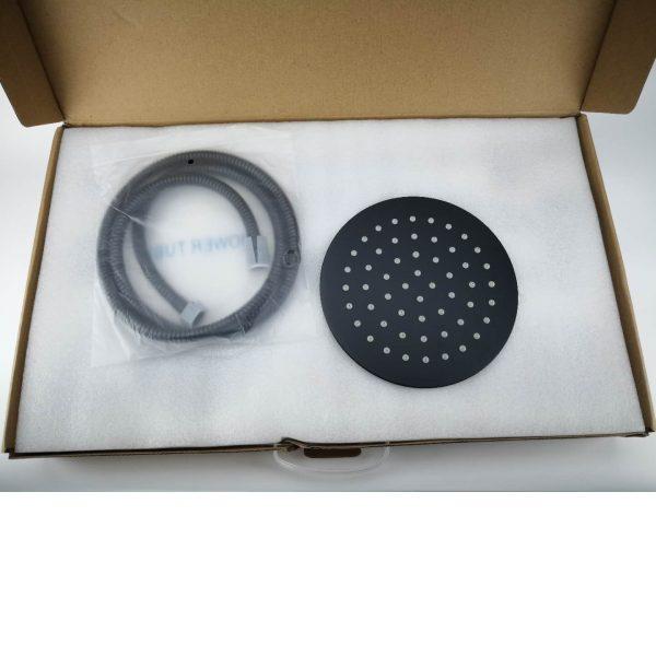 round black shower head and hose